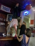 Doing handstands on the bar...well, not me, but her. LOL